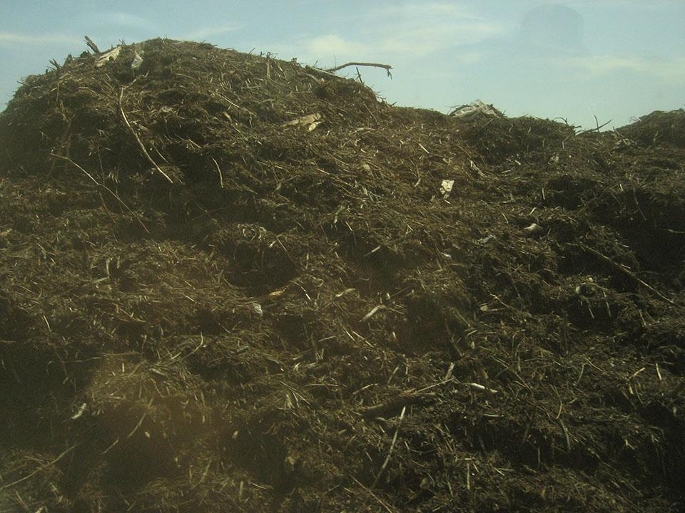 Huge pile of rich soil like compost