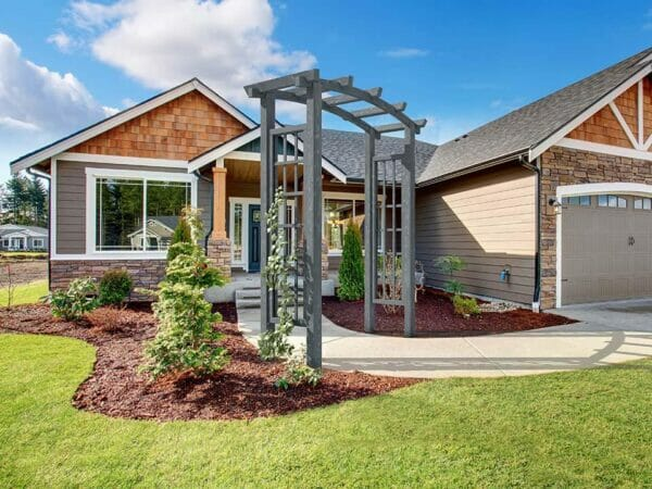 Dove Grey Athena Wooden Garden Arbor in front of the house