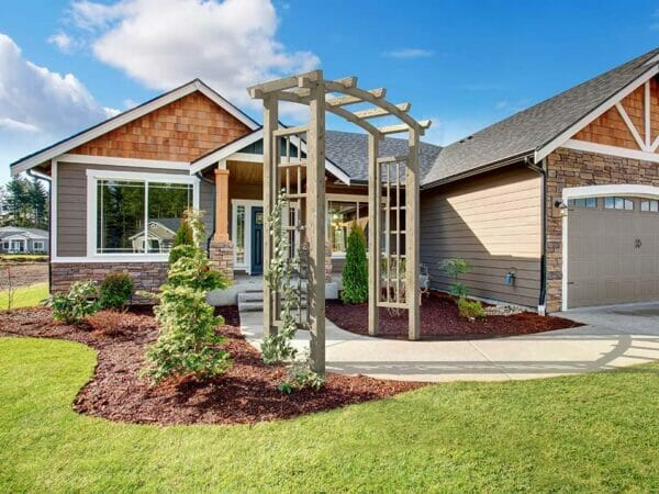 Natural Athena Wooden Garden Arbor in front of the house