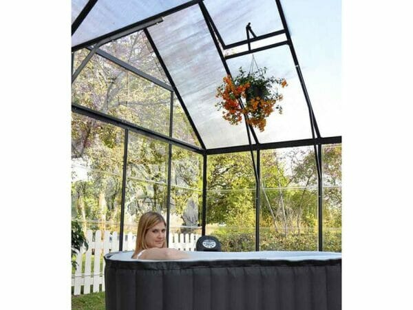 Palram Chalet 12ft x 10ft Hobby Greenhouse HG5400 - view from the inside - a woman on a bathtub