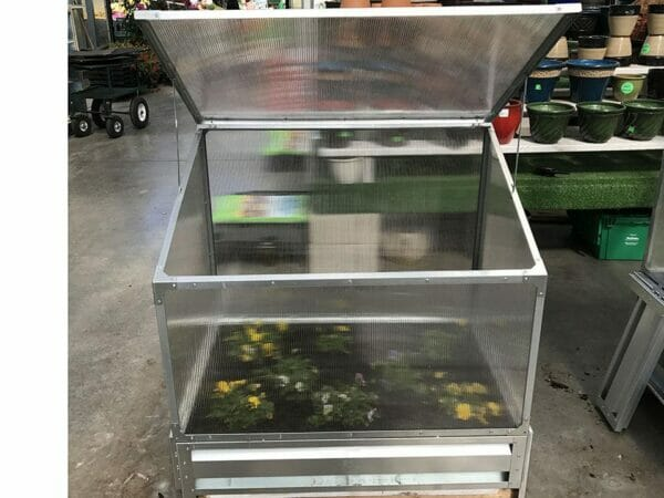 Delta Park Single Cold Frame. Top view. Open Roof panel. With Plants inside