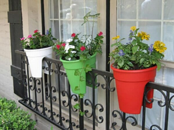 Three ELHO Round Corsica Flower Bridge Planters Hanging Outdoors