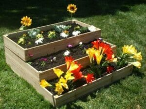 Eden Waterfall and Pyramid Raised Garden Bed Three layers with flower plants
