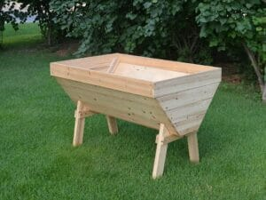 A V-Shaped Garden Table made from solid wood on a lawn