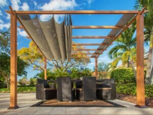 Florence Aluminum Pergola with the look of Canadian Cedar  Wood Grain Finish  and a Sand Color Convertible Canopy