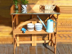 Folding Potting Bench with Zinc Surface with plants and tools