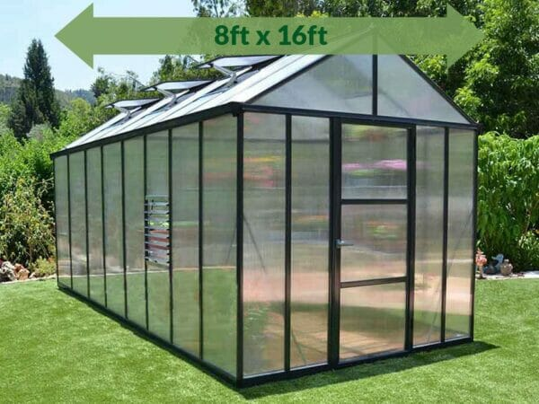 Palram Glory 8ft x 16ft Hobby Greenhouse HG5616 - full view - green arrow on top - in a garden