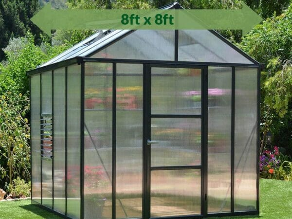 Palram Glory 8ft x 8ft Hobby Greenhouse HG5608 - full view - green arrow on top - in a garden