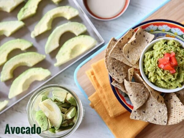Frozen dried avocado on tray and avocado served fresh after freeze drying