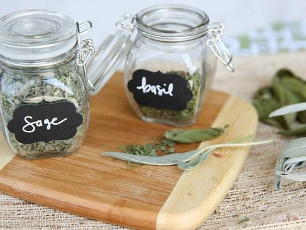 Frozen Dried sage and basil in a jar.