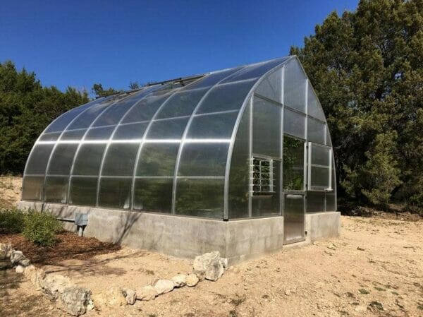 Hoklartherm Riga XL 9 Greenhouse 14x30 side view in a field set up