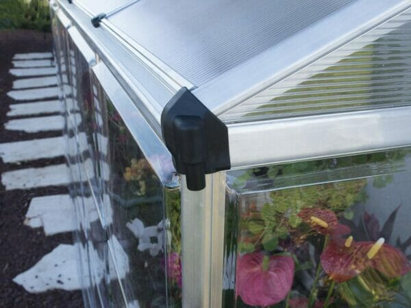 Palram 4in x 8in Hybrid Lean-To - in close up - corner downspout -  with plants inside for Palram accessories