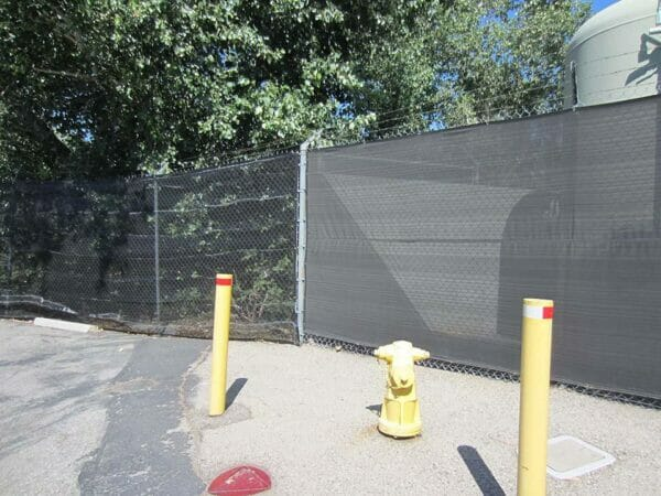 Riverstone Black Knitted Shade Cloth as a privacy fence