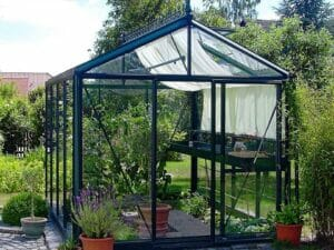 Janssens Royal Victorian VI23 Greenhouse exterior view highlighting one piece vertical glass, shade clothes in use, door open