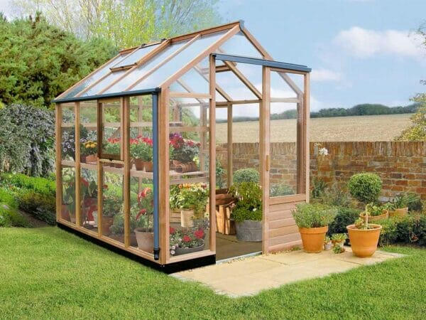 Juliana Classic Greenhouse 6ft x 8ft - front and side view - closed roof vents and window - open door - with plants inside - in a garden