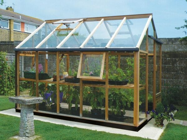 Juliana Classic Greenhouse 8ft x 10ft - slightly opened windows - open roof vent - side view - in a garden