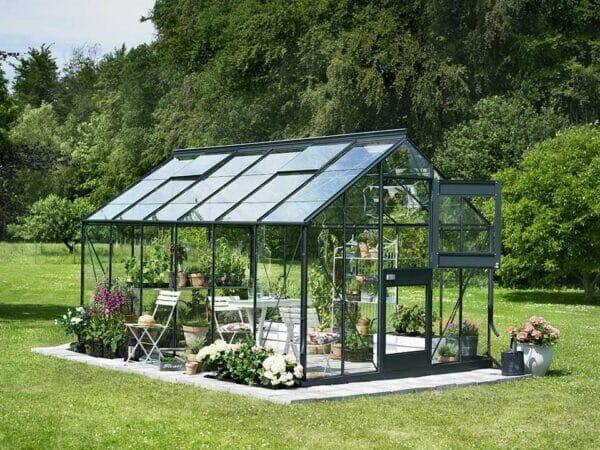 Juliana Junior Greenhouse 9ft x 14ft - Antharcite 3 mm Horticultural Glass - uuper hinged door open - in a garden
