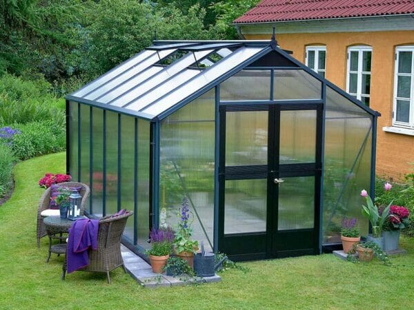 Juliana Premium Greenhouse 9ft x 14ft 10mm Polycarbonate. Left roof windows open. Closed door.