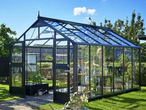 Juliana Premium Greenhouse 9ft x 14ft Anthracite 3mm safety glass with three people inside