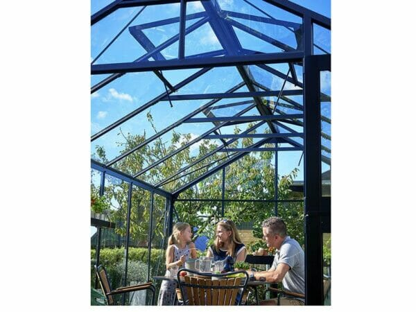 Juliana Premium Greenhouse 9ft x 14ft Anthracite 3mm safety glass showing roof interior and three people inside
