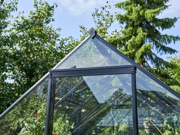 "Close-up shot of the gable of the Juliana ""The Qube"" Greenhouse 7ft x 11ft showing the sliding door device"