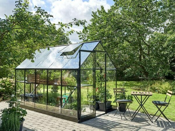 Side view of the Juliana Qube Greenhouse 7ft x 11ft with open sliding door