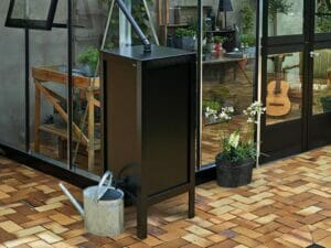 Juliana Water Butt Rain Barrel installed in an elegant greenhouse