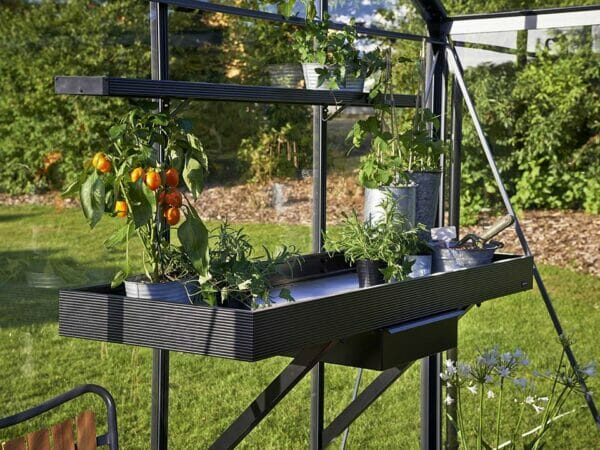 Side view of the Juliana Seed Tray Shelf with Drawer in a greenhouse