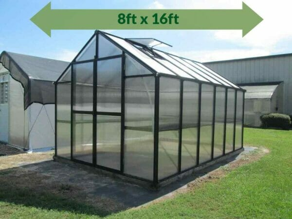 Riverstone Monticello Greenhouse 8x16 - Premium Package - full view - green arrow on top showing dimensions - closed door