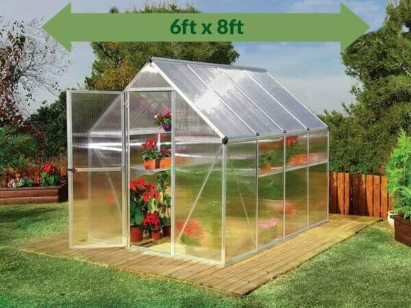 Palram Mythos 6ft x 8ft Hobby Greenhouse HG5008 - full view - green arrow on top with dimensions - in a garden