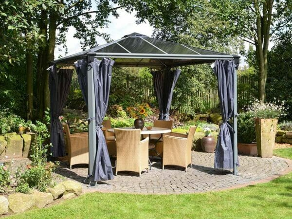 Opened Palermo Gazebo Curtain Set - 4 Piece installed in a gazebo - in a garden