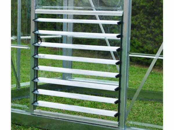 Open Palram Side Louver Window - attached to an empty greenhouse