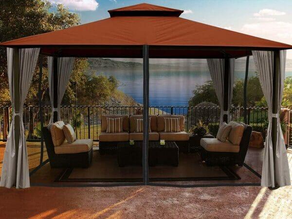 Santa Cruz Gazebo with Rust Sunbrella Top and Open Privacy Curtain and Closed Mosquito Netting