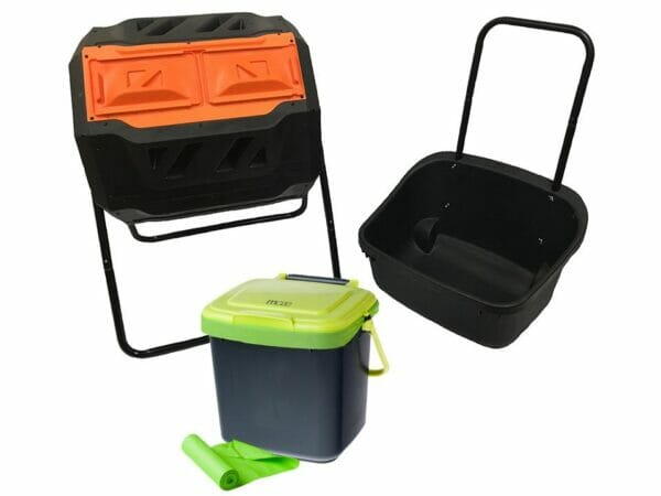 RSI Tumbler Composter with a black cart on the right, bin in the middle and green corn bags
