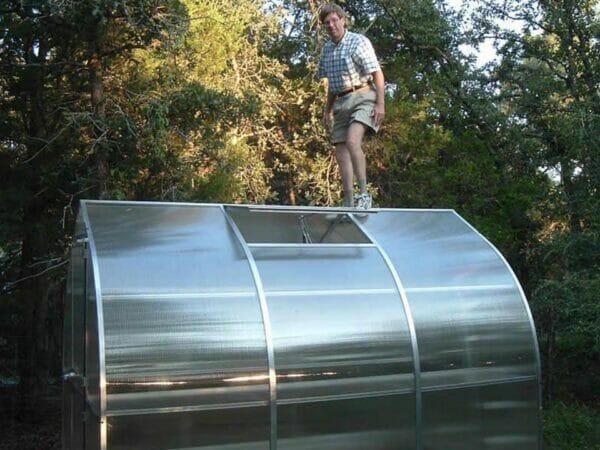 Heavy-duty construction Hoklartherm Riga 2s Greenhouse 7.8x7 man standing on peak of greenhouse