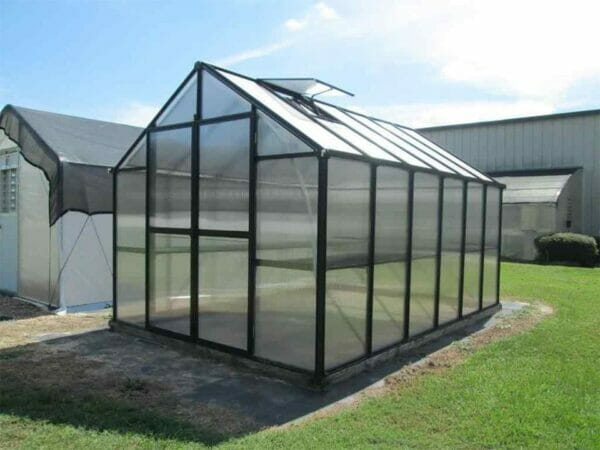 Riverstone Monticello Greenhouse 8x12 Premium package Polycarbonate greenhouse, front view, outdoor setting