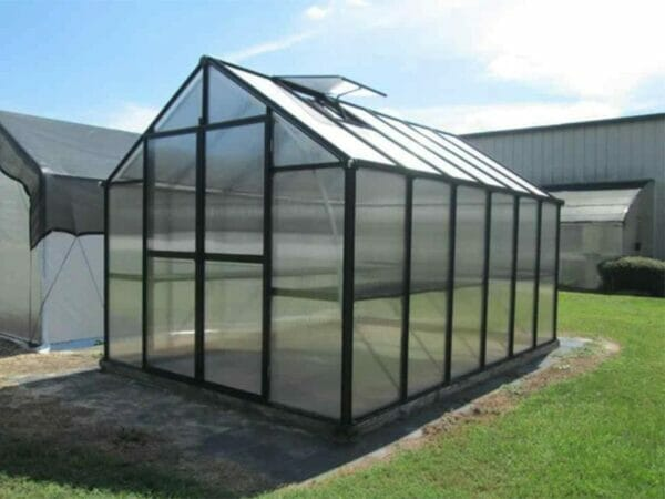 Monticello 8x16 Polycarbonate greenhouse on level surface, outdoor setting