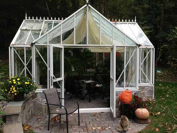 Front view of the Janssens T-Shaped Royal Victorian Antique Orangerie with opened double door