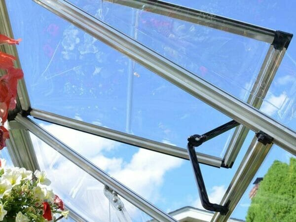 Inside top view of the Palram 6ft x 12ft Snap & Grow Hobby Greenhouse with flowers for Palram Hobby Greenhouse