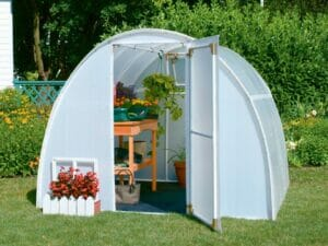 Solexx Early Bloomer Greenhouse 8ft x 8ft Front View with open door and visible interior with flower table