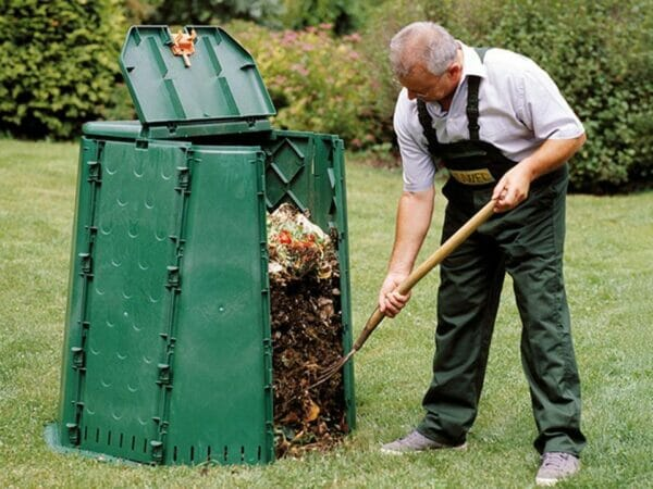 An old man using Aeroquick Composter
