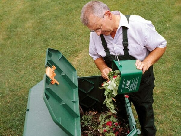 Easy to Use. Man pouring organic materials into the Aeroquick Composter