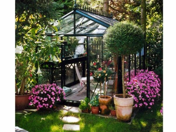 Front of the Janssens Royal Victorian VI 23 Greenhouse 8ft x 10ft located in a garden
