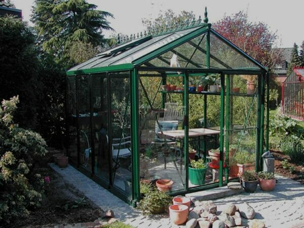 Janssens Royal Victorian VI 23 Greenhouse 8ft x 10ft used as a wintergarden with seating area