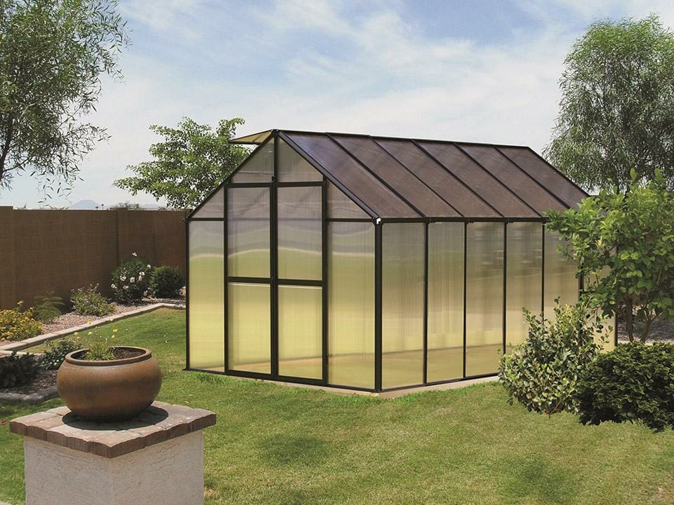 Black Monticello Premium Edition Greenhouse in a garden