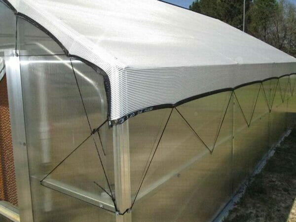 RSI Educational Greenhouse 63% Shade Cloth over greenhouse secured with tie downs