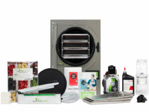 Small Harvest Right Freeze Dryer starter kit includes freeze dryer, power cord, oil pump, oil, oil filters, door cover, trays, tubing, owner's manual, impulse sealer, Mylar bags, oxygen absorbers