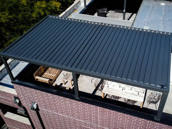 Aerial view of rooftop Selt System Sunbreaker 400 Pergola installation, black, slats closed