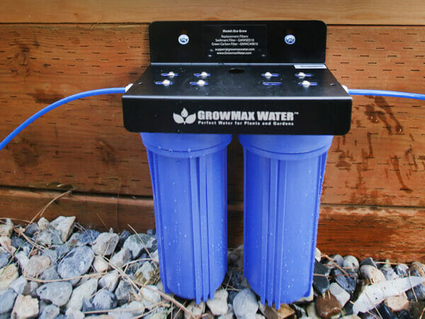 Installed GrowMax Water Eco Grow 240 in front of wooden planter