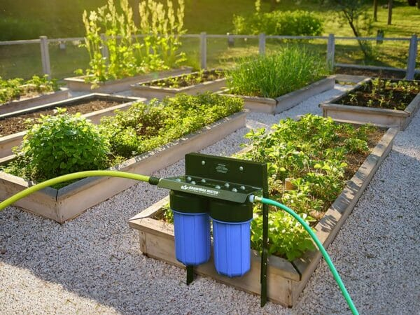 GrowMax Super Grow 800 installed in a garden with many raised garden beds